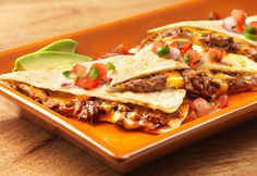 A slow-cooked batch of shredded beef made with Campbell's® Shredded Beef TacoSlow Cooker Sauce becomes the filling for this hearty quesadilla. Enclose the beef with some Cheddar cheese in a warm flour tortilla and pop in the skillet to make a simple quesadilla that's chock-full of flavor. Serve it with some favorite accompaniments like salsa, jalapeño pepperand diced red onion.