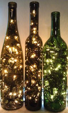 Recycled Wine Bottle Lights by OldGlassWithClass on Etsy. Easy DIY just drill small hole in back of bottle for cord. Empty Wine Bottles, Lighted Wine Bottles, Bottle Lights, Glass Bottles, Recycle Wine Bottles, Wine Bottle Lanterns, Glitter Wine Bottles, Glitter Vases, Bottle Lamps