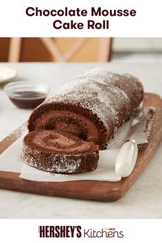 Get on a baking roll with this Chocolate Mousse Cake Roll. This light and airy recipe, made with HERSHEY'S Cocoa and HERSHEY'S Syrup, is a perfect chocolate cake for summer. Hershey's Chocolate Chips, Chocolate Mousse Cake, Chocolate Desserts, Chocolate Jelly Roll Cake Recipe, Chocolate Mouse, Chocolate Frosting, White Chocolate, Cake Roll Recipes, Dessert Recipes