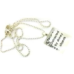 A fun little saying 'Distracted by shiney objects', this is so true for so many. This glass pendant necklace says it all.