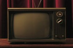 stock-footage-a-hand-turns-on-a-vintage-television-set-and-changes-the-channel-by-turning-the-tuner.jpg