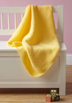Simple knitted baby blanket. I even love it in yellow.