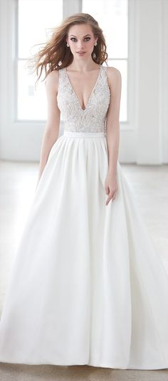 A silk Mikado skirt pairs beautifully with the dramatic beaded bodice of this A-line gown.