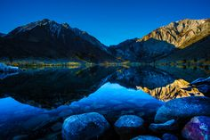 The crystal clear waters of Convict Lake provide a canvas for a beautiful reflection. Convict Lake is in the Eastern Sierra Nevada's along Highway 395 just south of Mammoth Lakes California...