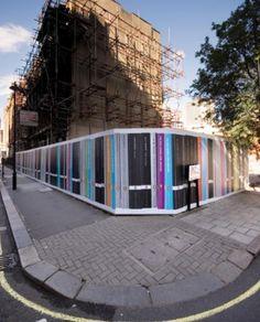 Multicoloured book spine effect construction hoarding. Creative hoarding design
