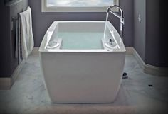 This #Tulsa bathroom makeover included a  free standing air tub with sleek lines and elegant fixtures. Soothing uncluttered walls create a sense of  visual relaxation to accompany the simplicity of this bath. Heated floors and towel racks complete the comfort ensemble. #remodel #bathroomremodel #japanesesoakingtub #ofuro #bathroom #spabath #modern #design #renovation #remodel #homeimprovement #interiordesign #style #homedecor