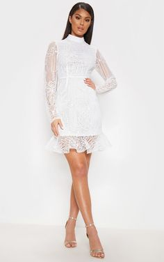 White Lace High Neck Bodycon DressChannel class and sass with this dreamy bodycon dress. White Lace High Neck Bodycon DressChannel class and sass with this dreamy bodycon dress. Bodycon Dress Formal, Edgy Dress, Bodycon Dress With Sleeves, Black Bodycon Dress, Classy Dress, Dresses With Sleeves, White Dress With Sleeves, Robes De Confirmation, Tight Dresses