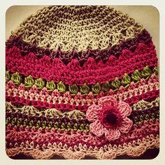 Ravelry: Jolly Girl Hat pattern by Agneta Kovacs PAID PATTERN I really like how all of these different stitches are combined to make this hat!
