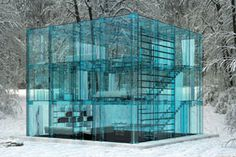Yes, please, we will live here. This is the Snow House, a place where showering might be a tad exposed, but the layout and architectural set-up is undeniable. The house was constructed by Milan based design firm, Santambrogio, and is built throughout with a  blue hued glass. The book cases, bed, and most everything is constructed with that same blue hued glass. Again, where do you shower?
