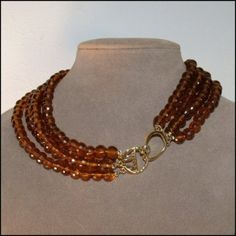 KJL Logo Clasp Amber Faceted Four Strand Beaded Necklace  $65.00  $40.00  Save: 38% off