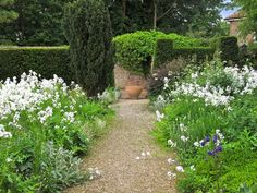 Collage of Life: Loseley Park..at the end of a path, in a white garden.