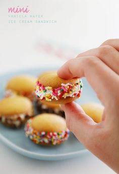 Mini Vanilla Wafer Ice Cream Sandwiches – The perfect quick + easy frozen treat! Roll in your favorite toppings and enjoy. thecomfortofcooking.com