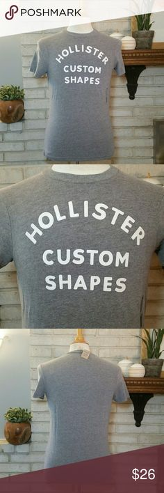 NEW Men's Hollister Graphic T Tee Shirt Grey S This is for a Brand new, with tags, 100% authentic men's Hollister Co. graphic T shirt. It is short sleeve, 60% cotton, 40% polyester. It is size small, and brand new. It has a decal logo. Smoke free home! Many styles and sizes listed. Mix and match with newly listed NEW American Eagle, NEW Hollister, and NEW Abercrombie & Fitch to get a bundle discount! See size chart pic listed. Hollister Shirts Tees - Short Sleeve