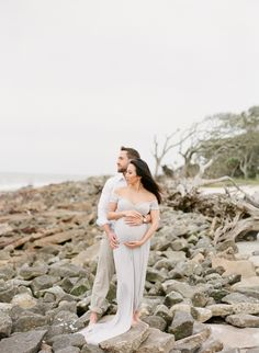 Fine Art Maternity Session | Driftwood Beach | Christine + David | Grey Dress | The Happy Bloom Fine Art Photography | www.thehappybloom.com | Baby Belly | Maternity Posing