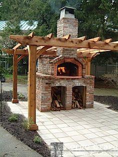 Arbor.  Google Image Result for http://www.fornobravo.com/graphics/outdoor_kitchen/arbor2.jpg