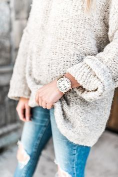 big comfy sweater, skinny jeans and fabulous watch.