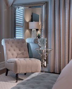 In a corner of the master bedroom, a shingle chair and small side table adds comfort to the space. Note light reflectance generated by placement of the ceiling to floor mirror.