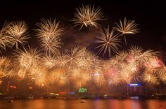 Fireworks explode over Victoria Harbour in Hong Kong on January 1, 2014. A wave of pyrotechnic displays kicked off new year celebrations in ...