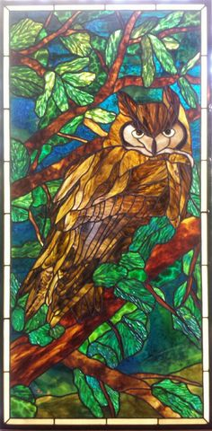 His Majesty, great horned owl in stained glass designed from a photo by Richard Hahn. Michelle Carlson, rockledgeglassdesign.com. Uroboros, Kokomo and Youghiogheny glass used.