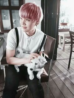 The way he's practically curled around the dog is so precious x3