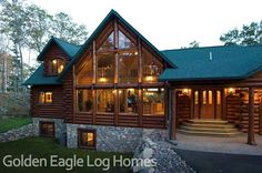 Notice the beautiful stairs and front door on the Lakehouse 3352AL  Photos and floor plans of this custom home are at www.GoldenEagleLogHomes.com  #loghomes #loghome #logcabins #cabin #logcabins #home #homes #houzz #rusticliving #outdoors #nature #loghomeliving