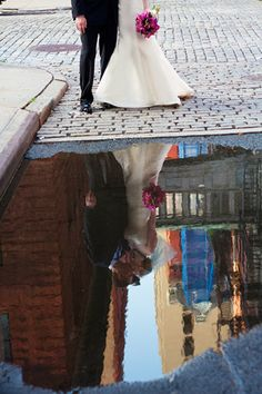 Rain puddle reflection! Such a great shot for a wedding photo.