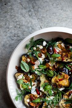 yotam ottolenghi's aubergine & herb salad with garlic yoghurt dressing.