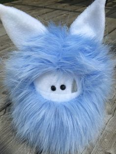 Blue and white Fuzzling - visit my website to find me online or in person for adoption of this plushie