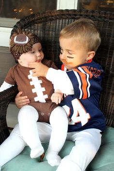football player and baby football. yep this will happen with my kids one day minus the blue and orange