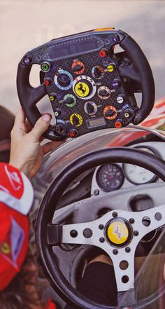 Ferrari racing steering wheel then and now.