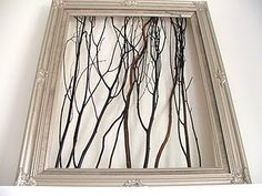 easy diy art... find sticks or branches and empty frame and hot glue to back of frame. spray paint frame and/or branches for additional effect
