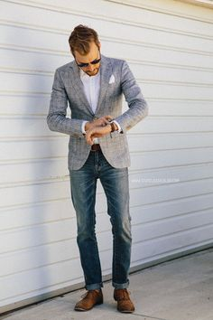Men's Grey Plaid Blazer, White Pocket Square, White Longsleeve Shirt, Brown Leather Belt, Blue Jeans, and Tan Leather Oxford Shoes