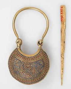Temple Pendant and Stick Date: ca. 1080–1150 Geography: Made in Constantinople Culture: Byzantine Medium: Cloisonné enamel, gold Dimensions: Overall: 1 15/16 × 15/16 in. (4.9 × 2.4 cm) Length stick: 2 × 1/16 in. (5.1 × 0.2 cm) Classification: Enamels-Cloisonné Credit Line: Rogers Fund, 1990 Accession Number: 1990.235a, b