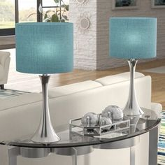 Each lamp showcases a bold round base that curves into a lovely hourglass brushed nickel body crowned with a drum shade wrapped in beautiful turquoise linen. Hourglass body design in a modern brushed nickel finish. Metal Table Lamps, Table Lamp Sets, Glass Table, Grommet Curtains, Panel Curtains, Curtain Panels, Table Turquoise, Turquoise Fabric, Teal