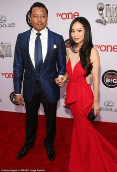 Terrence and Miranda Howard. Still unsure what either of them are wearing, but I love her dress.NAACP Image Awards 2014.