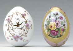 TWO RUSSIAN PORCELAIN EGGS, 20TH CENTURY. The first painted with an oval gilt-rimmed panel enclosing a rose bouquet on a pale pink ground; the second transfer-printed with a cartouche of swallows amongst floral sprays on a white ground the reverse with Cyrillic inscription.