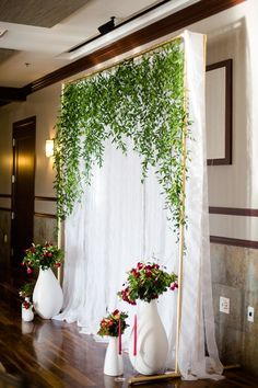 vine wedding backdrop - photo by Rachel Gomez Photography http://ruffledblog.com/italian-wedding-inspiration-with-pops-of-red