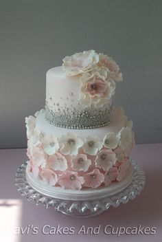I love the top tier without the flowers.  Maybe a 50 on top with your roses on the bottom?