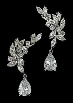 14 karat white gold and diamond earrings   Wheat form accented by a single 1.15 carat pear shape diamond drop on each earring, total diamond weight approximately 3.3 carats.