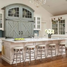 LOVE a barn door!  And the built in look of the fridge and freezer with the built in storage above!
