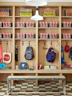 In the mudroom, each child has a locker where backpacks, sports equipment, jackets, and hats belong. Theres even bench seating to take off shoes and boots. Red-and-white lined metal bins act as catchalls for quick cleanup and out-of-season storage. Declutter Your Home, Organizing Your Home, Home Organization, Electronics Projects, Open Kitchen Layouts, Metal Bins, Small Chalkboard, Flea Market Decorating, Modern Rustic Decor