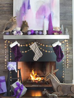 Welcome Kris Kringle and the holidays with a stunning mantel and fireplace design. From chalkboards to banners to miniature mittens, set the mood with these fresh Christmas decorating ideas.