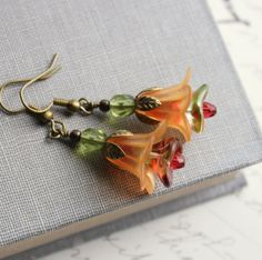 Orange Flower Earring, Lucite Earrings, Green Glass, Flower Jewelry, Beaded Earrings. $24.00, via Etsy.