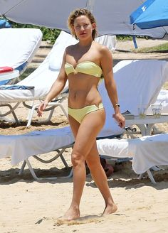 Kate Hudson popped in a lemon-hued swimsuit, with V-shaped cutouts on the top and bottom. Get her swimsuit details!