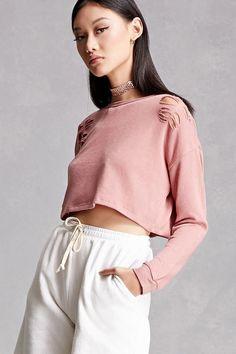 f303c5bc26a37 A lightweight crop sweatshirt featuring an allover distressed design with  raw-cutouts