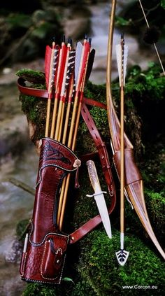 Archery, small side-quiver, bow and dirk.