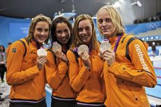 Netherlands  From left, Netherlands' Marleen Veldhuis, Ranomi Kromowidjojo,Femke Heemskerk and Inge Dekker pose with their silver medals for the women's 4x100-meter freestyle relay swimming final at the 2012 Summer Olympics, Saturday, July 28, 2012, in London. (AP Photo/Mark J. Terrill)