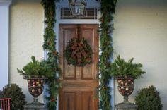 Can you ever have too much greenery on the front door? I think not.