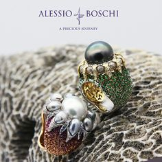 BRAIN CORAL Ring from THALASSA Collection in White and Yellow Gold with contrasting color galleries featuring the coral pattern's structure and a tropical starfish gem encrusted.  The multiple arms of the multicoloured starfish on the jewels are encrusted with rustic grey and white diamonds.  The center features a large green Tahitian South Sea Pearls over a ring's body shaded with matching color tsavorites.