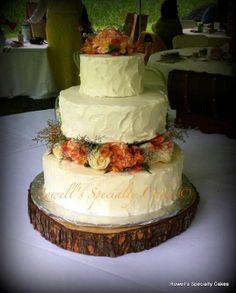 Rustic wedding cake, fresh flowers
